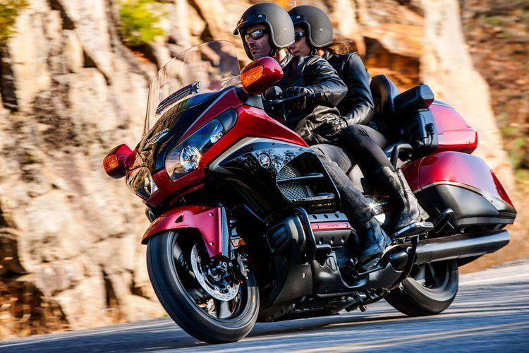 Man & Woman Riding a Gold Wing Motorcycle